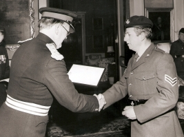 LORD LT of CORNWALL LORD FALMOUTH presenting CPL MICHAEL (NOBBY) CLARKE WITH HIS TA SERVICE CERTIFICATE