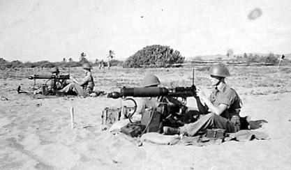 Two guns in action at Port Royal. Jamaica. Jack Madron on nearest gun and Cpl John Fisher is number one on the other gun. We were live firing out to sea.
